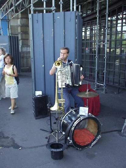 [Orsay Museum] Outside the Musee d'Orsay (Orsay Museum) was what must have been the most talented musician in the world... a guy playing the trombone, accordian, symbols, and drums, all at the same time!