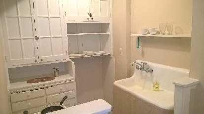 minimalist kitchen, white cups, plates, bowls, glasses