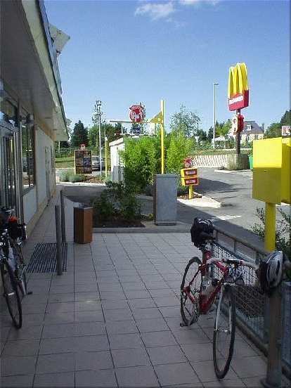 [KM 695, 43:08 elapsed, 5:08 p.m.] Ravenous for calories, I stop off at a McDonald's in Carhaix...