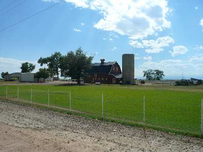[Mile ~137, 3:37 p.m.] A farm between Johnstown and Platteville.