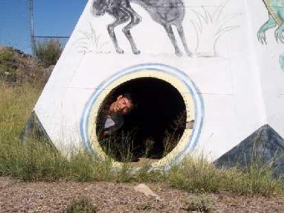 Felix Wong inside a teepee.