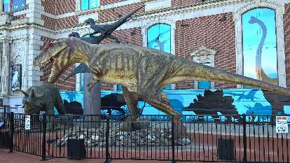 Triceratops and Tyrannosaurus rex dinosaurs outside the Academy of Natural Sciences.