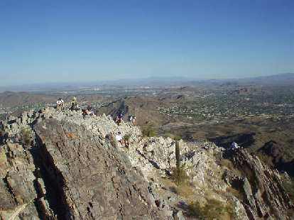 We went for another hike on Sunday morning, this time on Piestewa Peak.  This time we starting hiking by 7:00 a.m. so the weather was more tolerable.  I've never seen so many hikers before esp. at this time of morning.  Here's a few of them at the top.