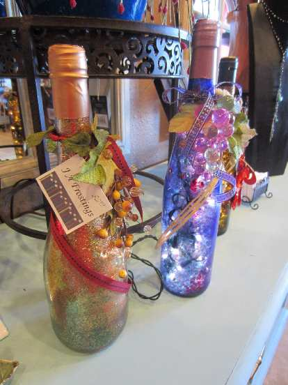 Wine bottles with holes drilled in them for inserting x-mas lights.