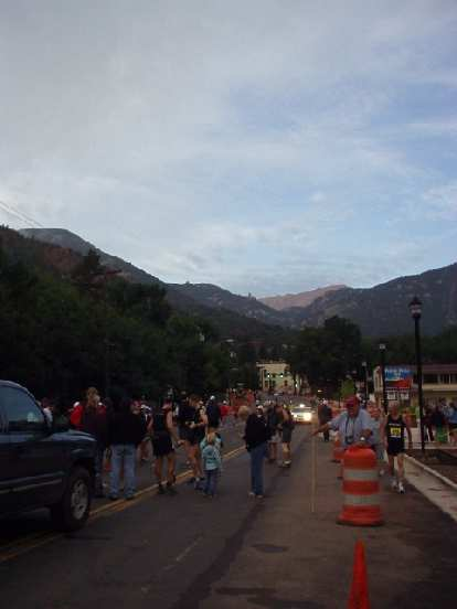 [Mile 0, 6:47 a.m.] The sun rose over Pikes Peak with reddish colors before the race.