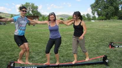 Felix, Diana and Lauren on the slack line at Outdoor Day.