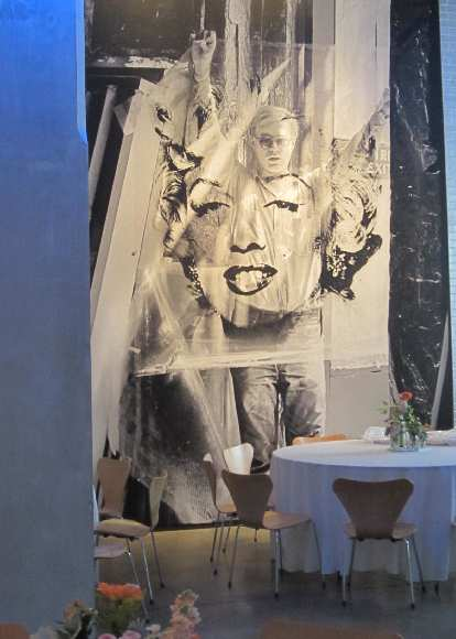 A superposition of Marilyn Monroe and Andy Warhol inside the Warhol Museum.