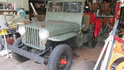 Kristina's neighbor Kevin showed me his Willys Jeep from the late 1940s. He bought it for under $2,000 but has put in more than $20,000 into it since.