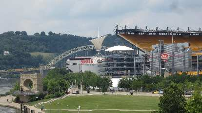 The Mr. Rogers Memorial (lower left) in front of Heinz Field and the Carnegie Science Museum.