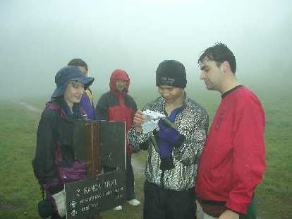 Felix Wong and others checking the map after a couple of wrong turns.