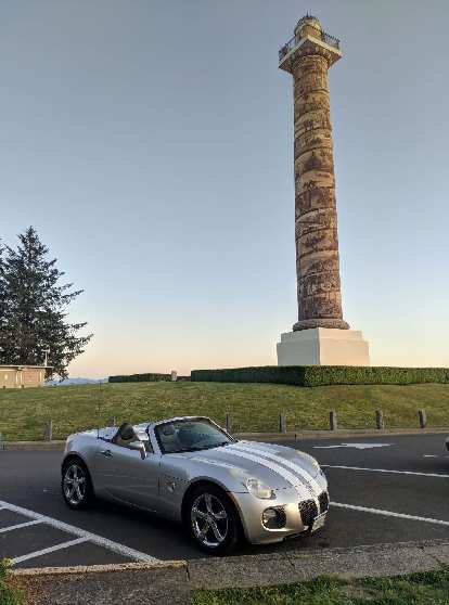 Silver Pontiac Solstice GXP in front of the Astoria Column in Astoria, Oregon.