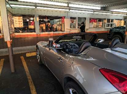 Having dinner inside a Pontiac Solstice GXP at the A&W drive-in restaurant in Florence, Oregon.