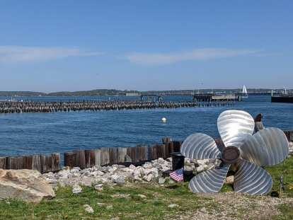 A propeller and U.S. flag by the harbor in downtown Portland, Maine.