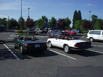 """Elaina and a white '90 Spider.  """"I don't get to drive it in the winter,"""" said its Portland owner."""