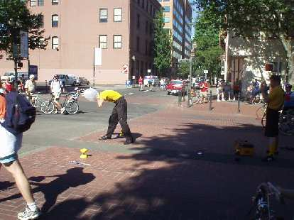 For the annual Bite of Oregon festival, these two young gentlemen were sent out to do some stunts (like juggle flames) to advertise the Bite of Oregon.  As his last stunt, this guy blew up a latex glove around his head until it burst.
