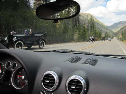 Ford Model Ts going up Highway 14.  We saw them earlier near Rustic while they were stopped.