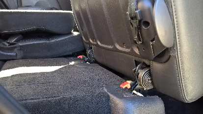 Detail of the latches holding the removable rear seats down to the floor.