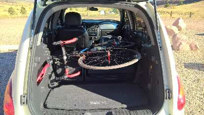 With the passenger and rear seats folded down, the PT Cruiser can carry a road bike with both wheels still attached.