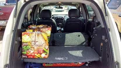 grocery bags on parcel shelf middle in position, PT Cruiser, flat floor
