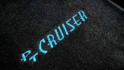 black PT Cruiser floor mat, blue letters