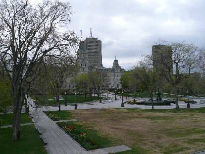 Plaza with trees and tall buildings in Quebec City.