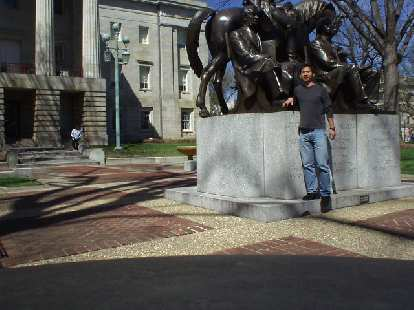 Felix Wong with a statue of Andrew Jackson.