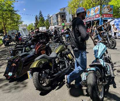 I liked the green custom Harley-Davidson cruiser in the center. The bike to the right of it with a turquoise trapezoidal fuel tank was interesting too.