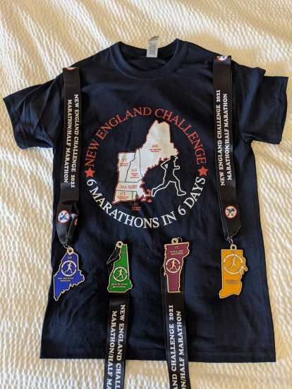 Finisher medals from Maine, New Hampshire, Vermont, and Rhode Island. I didn't run Massachusetts or Connecticut because I had run marathons in those states already.