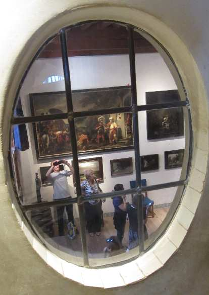View of the living room through an oval window.