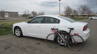 The 2014 Dodge Charger is so huge that by simply folding down the rear seats I could slide the Super Bike in without removing either of the wheels.