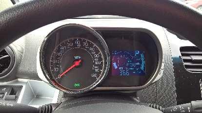 Motorcycle-inspired gauge pod inside a 2015 Chevrolet Spark.