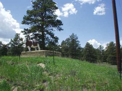 [Mile 101, 1:03 p.m.] Cow statue.