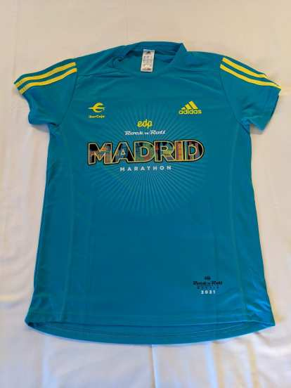 A green tech shirt was included with registration for the 2021 Rock 'n' Roll Madrid Marathon.