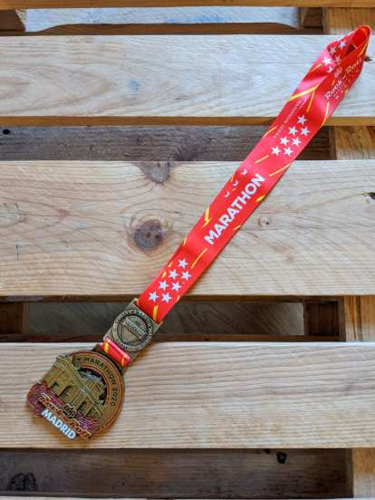 The finisher's medal for the Rock 'n' Roll Madrid Marathon.