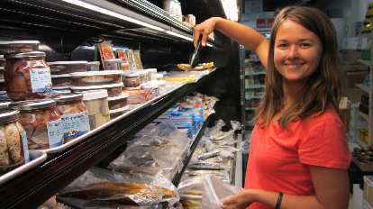 Katia picking out some fried anchovies.