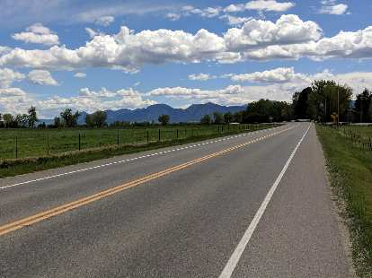 Mile 123: The view of the Flatirons from west of Longmont, Colorado.