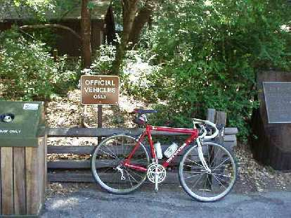 "[Mile 54, 12:02 p.m.] ""Official Vehicles Only"" to me included my official steed of 10 years of ultra-cycling, Canny, my racy red Cannondale.  This is at the Big Basin Headquarters water/toilet stop."