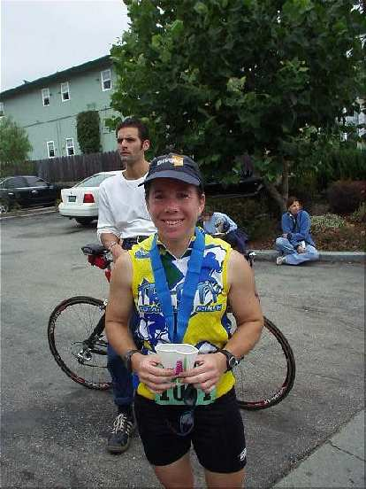 In fact, she ended up finishing 8th in her age group out of 103 women!  Here she is, all smiles with her medal around her neck and cup of Gatorade in hand.  A great day for a great gal!