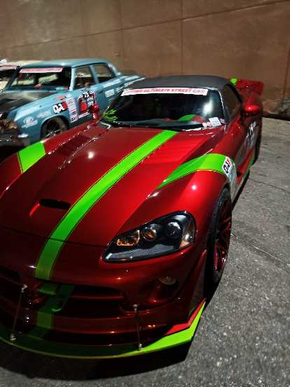 A red Dodge Viper with green stripes.