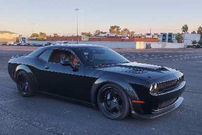 A black Dodge Challenger widebody.