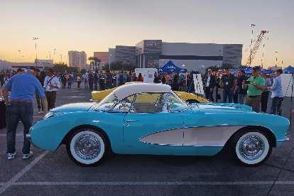 An aqua first-generation Corvette.
