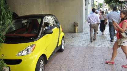 Yellow Smart Car.