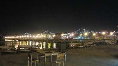 The Bay Bridge lit up.