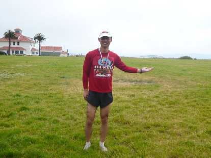 Felix Wong after the Alcatraz Challenge.  You can see Alcatraz a little bit above his hand in the distance.