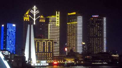 The Bund side of the Huangpu River at night.