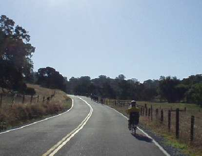 [Mile 25, 8:26 a.m.] A recumbent ahead in terrain that starts to get hilly.
