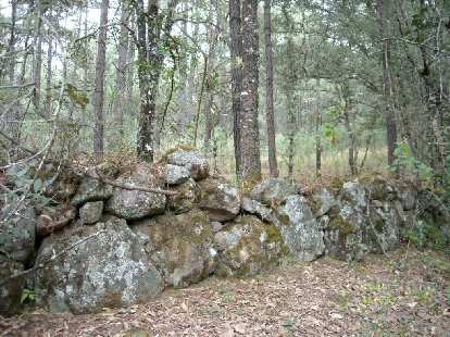 This wall was made around 1911.  It served as a barrier to hide behind against attackers.