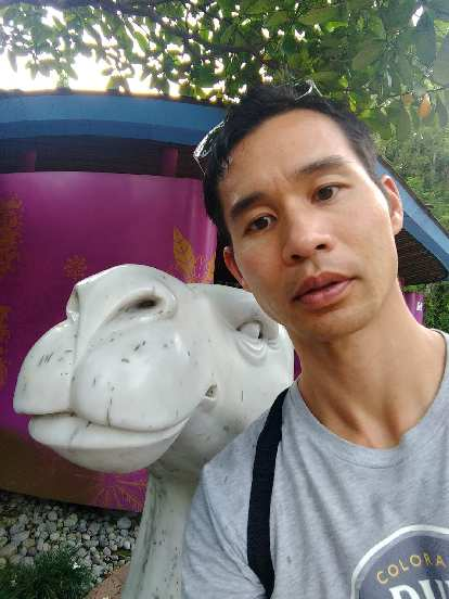 Me with a white camel statue at Gardens by the Bay in Singapore.