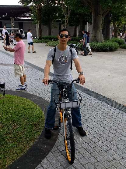 Felix Wong riding an o.bike city bike in Singapore.