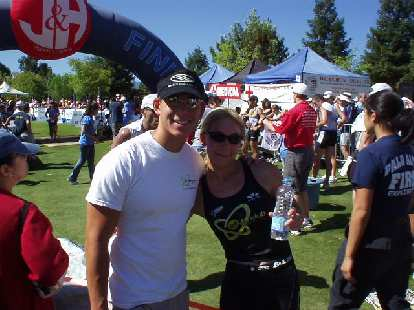 Lisa had a terrific race, in all 3 disciplines and esp. the run (7:22 pace).  Here she is with Terry...